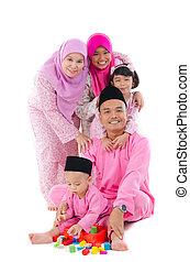 indonesian family having fun during hari raya