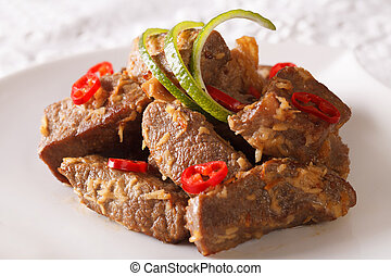 Indonesian Food: Beef rendang close-up. horizontal -...