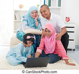 indonesian malay family having a good time surfing internet