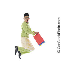 indonesian male shopping and jumping in joy during hari raya ramadan festival