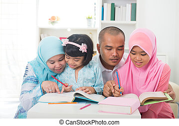 indonesian muslim family learning together with lifestyle backgr