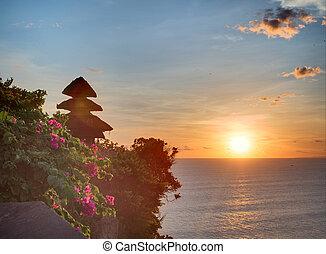 Sunset from the Pura Uluwatu temple on Bali island in Indonesia
