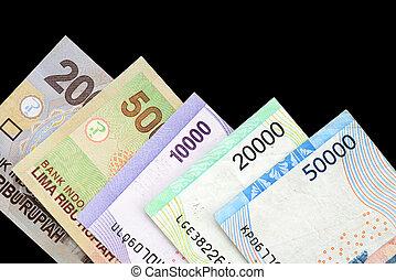 Indonesian rupiah on dark background close up