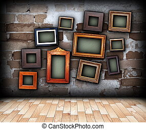 indoor backdrop with painting frames hung on wall