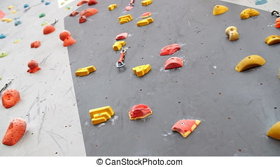 Indoor Climbing gym wall detail close up. - Indoor Climbing...