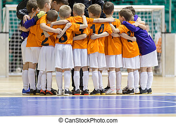 Indoor football soccer match for children. Kids boys winning game