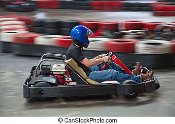 Indoor karting race (kart and safety barriers)