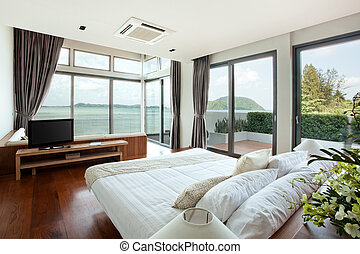 indoor - panoramic view of nice cozy bedroom with summer...