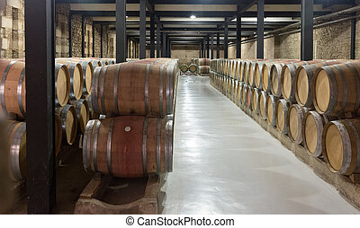 many wooden barrels in  winery