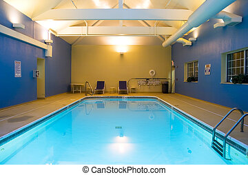 Indoor pool - Wide angle view of an indoor swimming pool in ...