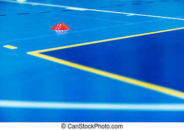 Indoor soccer futsal training field. Futsal training pitch with red cone and white and yellow pitch lines. School indoor football practice venue