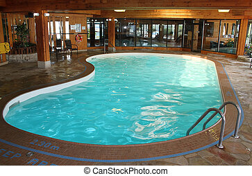 Indoor swimming pool with wood designed walls