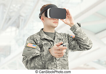 Indoors shot of USA soldier wearing VR glasses - Indoors...