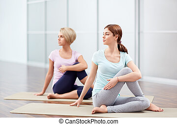 Indoors - Young girls do yoga indoors