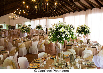 Indoors wedding reception venue with decor, selective focus...