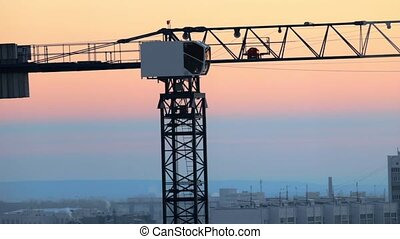 Industrial. A construction site. Hoisting cranes working....