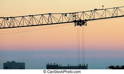 Industrial. A construction site. Hoisting cranes working...