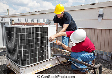 Industrial Air Conditioning Repair - Two workers on the roof...