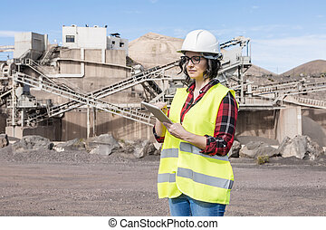 Industrial architect working with tablet on construction site