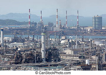 industrial area - Industrial plant with smoke stacks,...