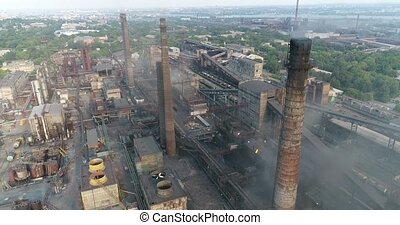 Industrial area top view, View of the industrial object, Courtyard of a factory, Aerial view, Smoke and fire, environmental pollution, environmental pollution, ecological disaster, panoramic view, 4K