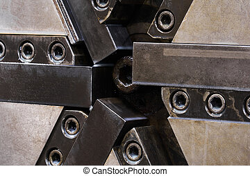 industrial background - lathe spindle chuck with six jaws close up