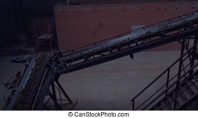 Industrial belt conveyor. Moving Raw Materials. Long...