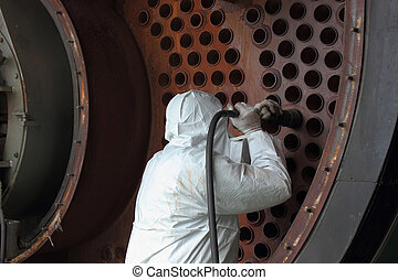 Industrial Boiler Clean - an engineer wearing full ppe,...