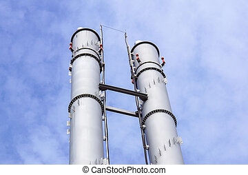 industrial boiler flues, against the blue sky