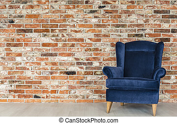 Industrial brick wall and armchair