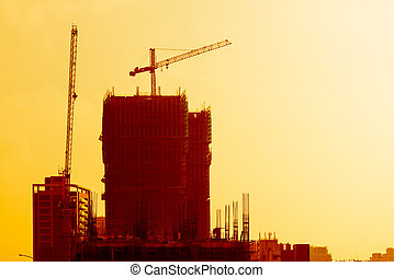 Industrial building site at sunset