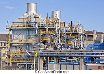 Industrial building with pipes and chimneys