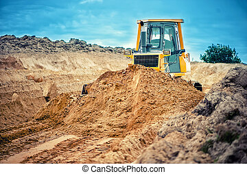 industrial bulldozer and excavator working with earth in sandpit