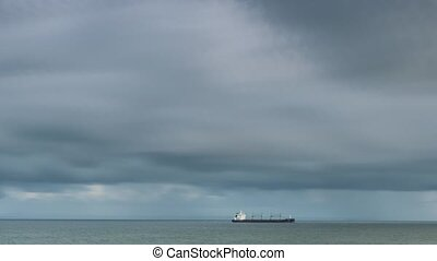 Industrial cargo ship in the open Atlantic ocean - timelapse...