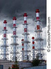 Industrial chimneys against the sky.