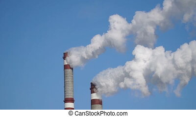 industrial chimneys emits toxic pollutants into the sky...