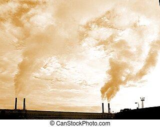 Industrial Chimneys - Smoke rising from industrial chimneys.