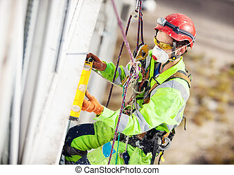Industrial climber during winterization works
