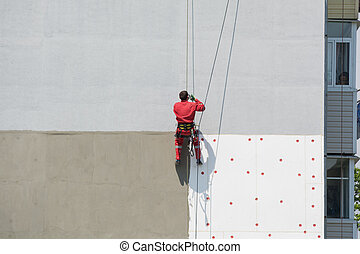 Industrial Climber On The Wall