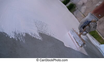 Industrial Climber Paints Wall of Facade with White Paint ...