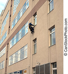 Industrial climber washes windows