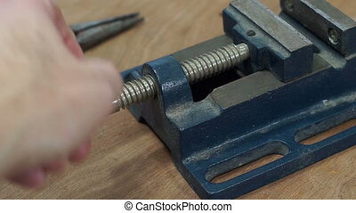 Industrial Closing Small Metal Vice - Anonymous person...