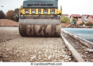 industrial compactor on construction site. Road paving and compacting during high way construction