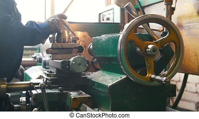 Industrial concept. Construction plant. A man working with a...