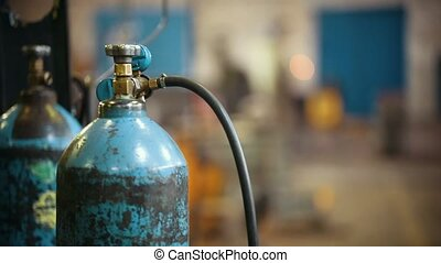 Industrial concept. Gas bottle on a manufacturing plant. Mid...