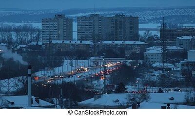 Industrial concept. Residential buildings. Traffic with a lot of cars