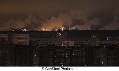 Industrial concept. Rows of buildings and pipes smoke out