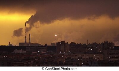 Industrial concept. Rows of buildings. Industrial pipes exhales the smoke