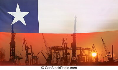 Industrial concept with Chile flag at sunset, silhouette of container harbor