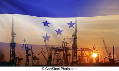 Industrial concept with Honduras flag at sunset, silhouette...